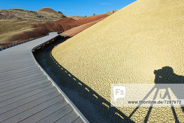 Painted Hills and photographer's shadow