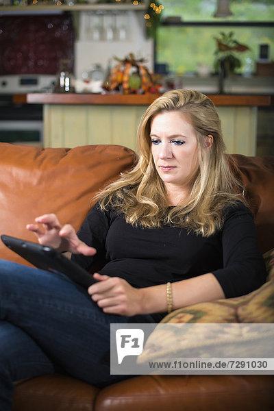 USA  Texas  Mid adult woman using digital tablet