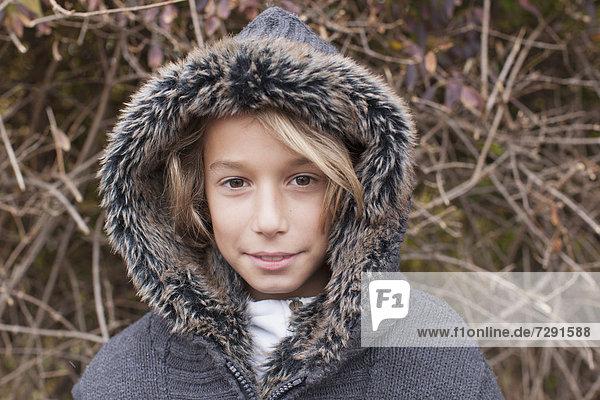 Boy with fur coat  portrait