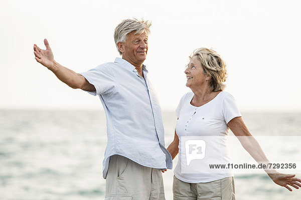 Spain  Senior couple having fun at the sea