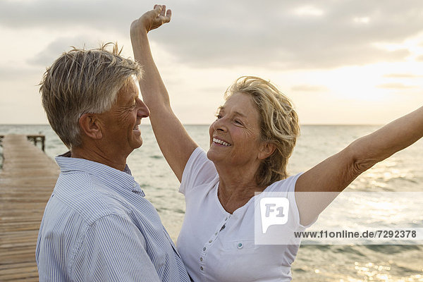 Spain  Senior couple embracing at the sea