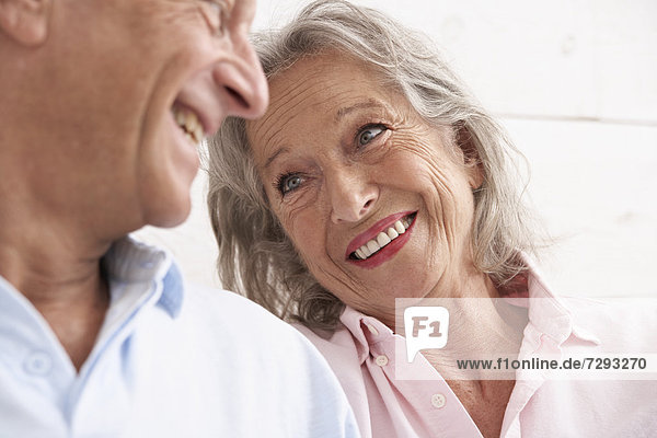 Spain  Senior couple looking at each other  smiling