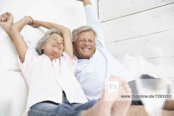 Spain  Senior couple waking up  smiling