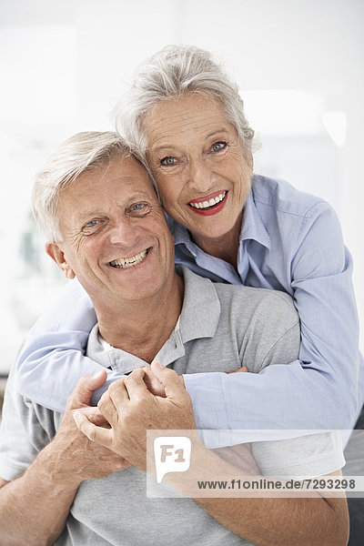 Spain  Senior couple in hotel  smiling  portrait