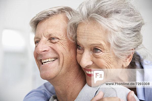 Spain  Senior couple looking away  smiling