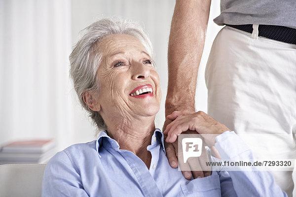 Spain  Senior couple holding hands  smiling