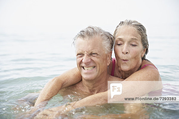 Spain  Senior couple swimming in sea
