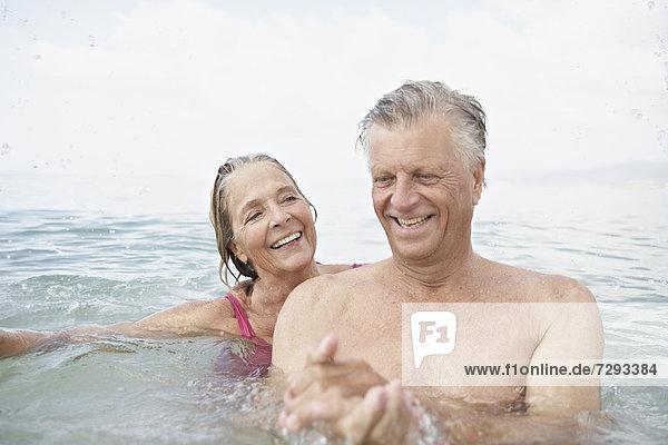 Spain  Senior couple swimming in sea