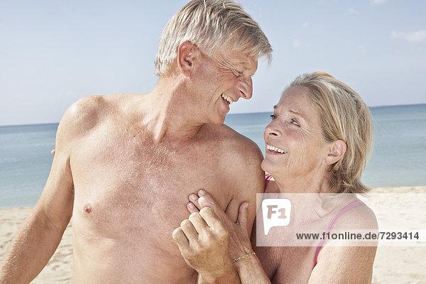 Spain  Mallorca  Happy senior couple at beach