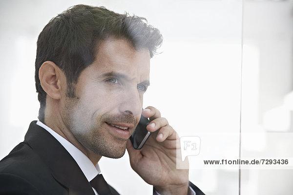 Spain  Businessman talking on mobile phone