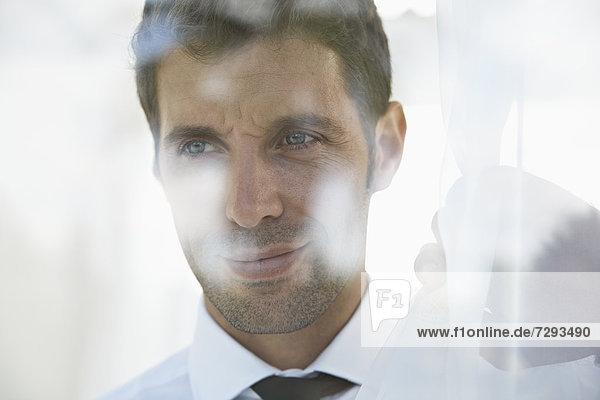 Spain  Businessman thinking  smiling