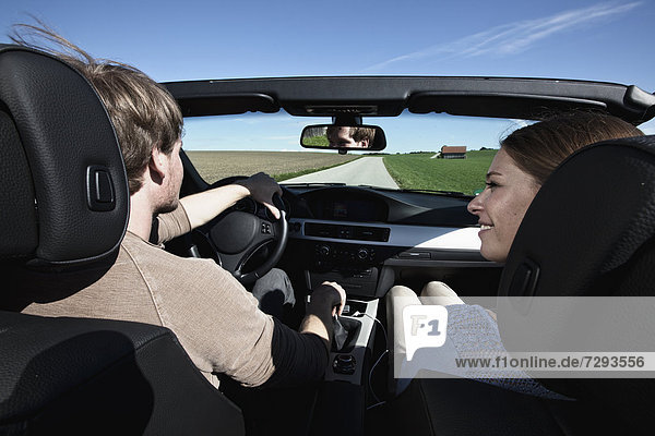Germany  Bavaria  Couple in car  smiling
