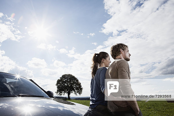 Germany  Bavaria  Couple standing by car