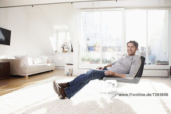 Man sitting on chair  smiling