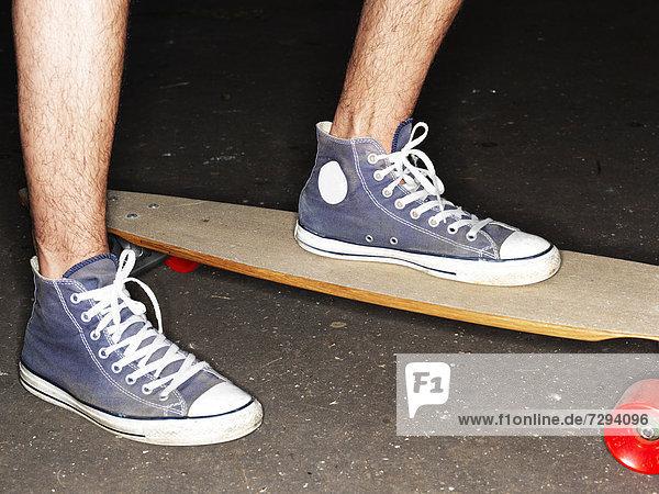 Germany  Duesseldorf  Human foot on skateboard  close up Germany, Duesseldorf, Human foot on skateboard, close up