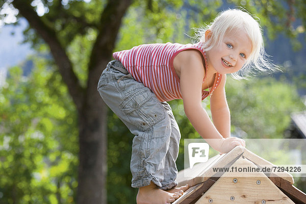 Germany  Girl playing on playground