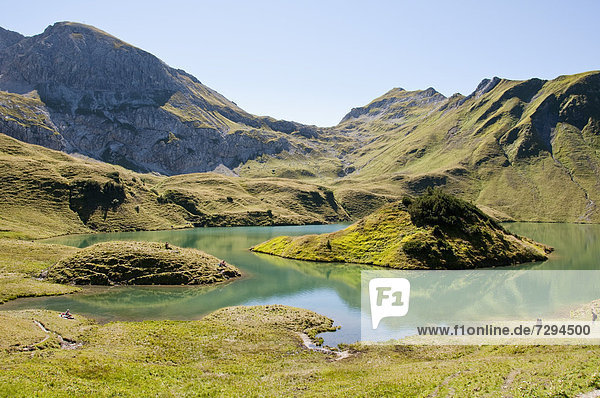 Germany  Bavaria  Hikers on Schrecksee Lake