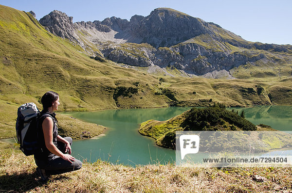 Mid adult woman looking at Schrecksee Lake