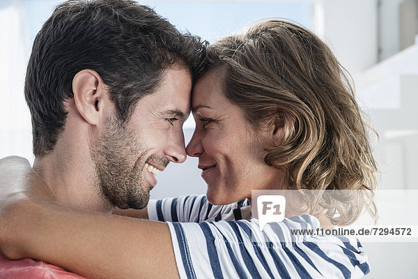Spain  Mid adult couple embracing each other in modern apartment