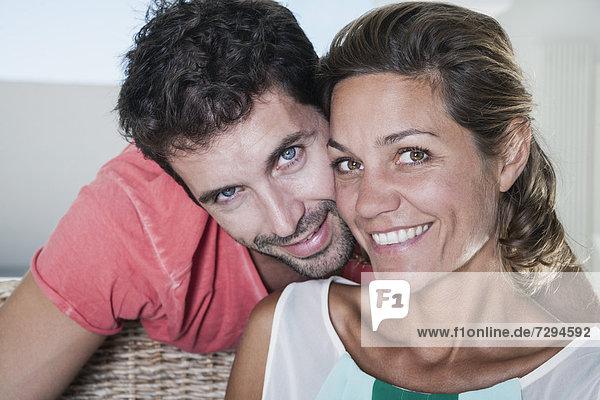 Spain  Mid adult couple smiling  portrait