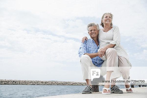 Spain  Senior couple at harbour  smiling
