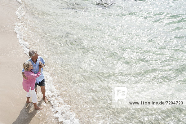 Spain  Senior couple standing beach