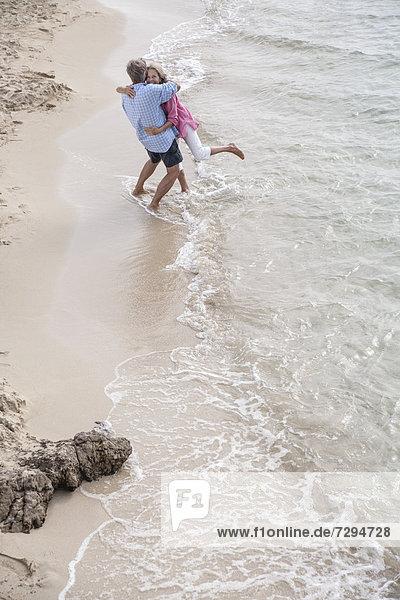 Spain  Seniors couple embracing at beach