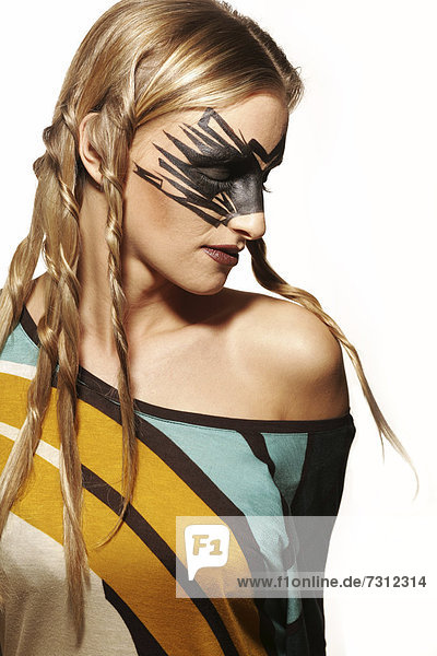 Young woman wearing extreme make-up