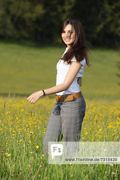 Woman  22 years  in a spring meadow