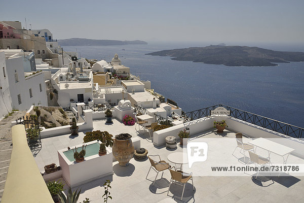 View from the rim over the rooftops into the Caldera,  OÌa,  Santorini,  Cyclades,  Greek Islands,  Greece,  Europe