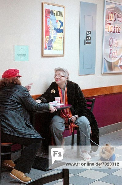 New York City  ladies chatting at a Dunkin' Donuts café in Jackson Heights  Queens