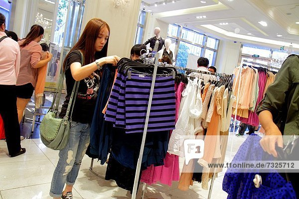 China  Shanghai  Huangpu District  East Nanjing Road  National Day Golden Week  US company in foreign setting  Forever 21  department store  shopping  Asian  woman  clothing  fashion  retail display  for sale