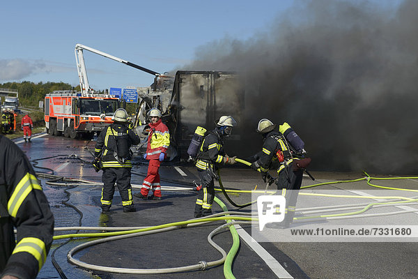 'An airport fire engine is helping to extinguish at a truck fire on the A8 motorway near the ''Echterdinger Ei'' junction  Stuttgart  Baden-Wuerttemberg  Germany  Europe'