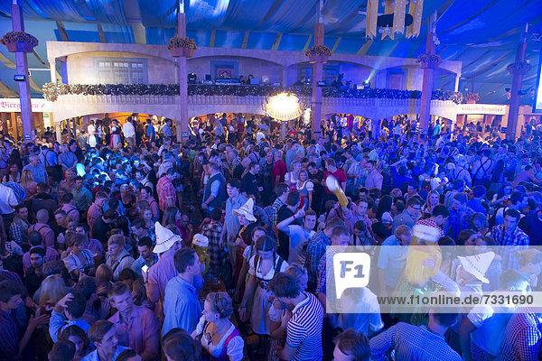 Party in a beer tent  Cannstatter Wasen fairground  funfair  Bad Cannstatt  Stuttgart  Baden-Wuerttemberg  Germany  Europe