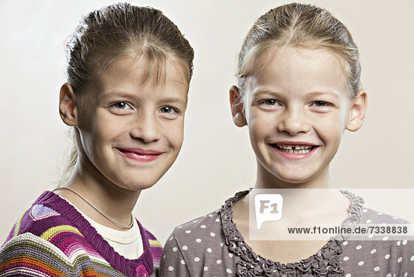 Fraternal twins smiling into the camera