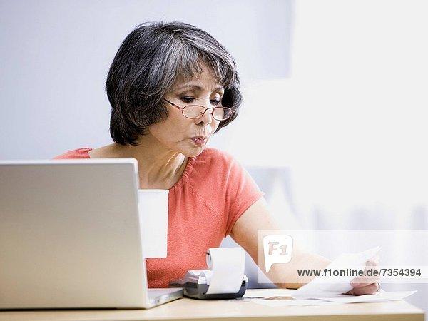 senior woman using a laptop computer
