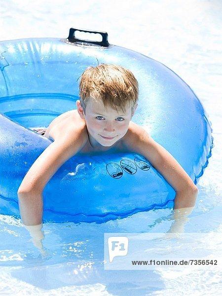 boy in an inner tube