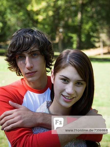 Close_up of a teenage couple in the park