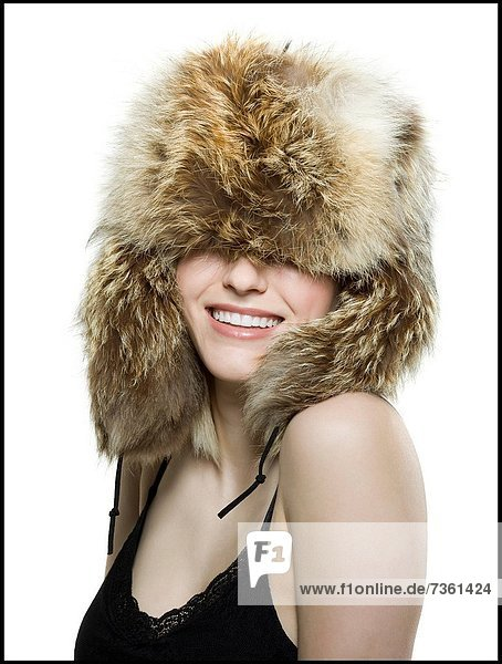 Close_up of a young woman wearing a fur hat