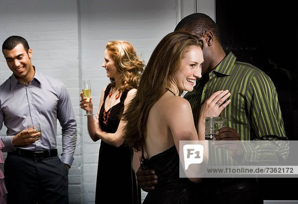 Close_up of man whispering to woman