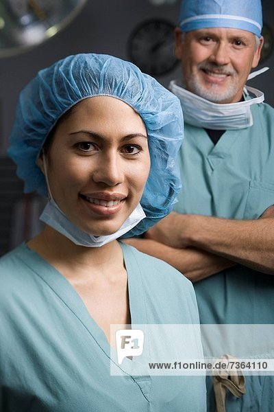 Portrait of a female surgeon and a male surgeon smiling
