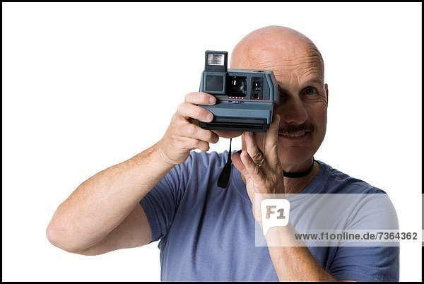 Portrait of a mature man taking a photograph