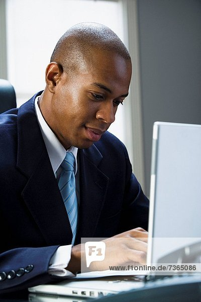Businessman working on a laptop computer