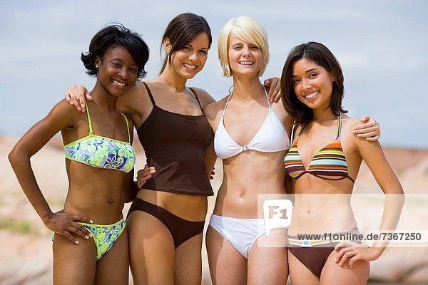 Portrait of four young women in bikinis