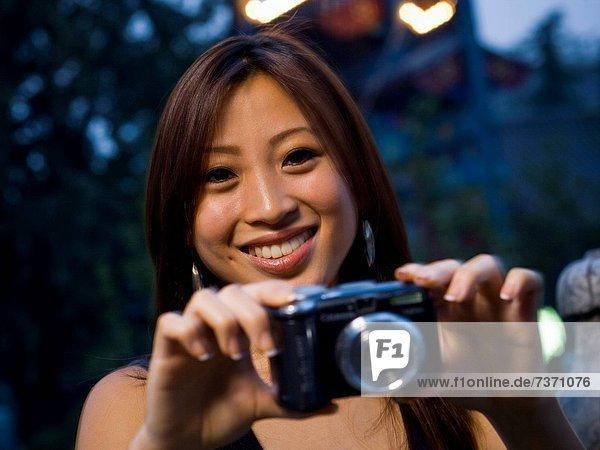 Frau  Fotografie  nehmen  lächeln