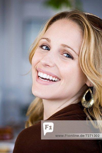 Closeup of woman smiling outdoors