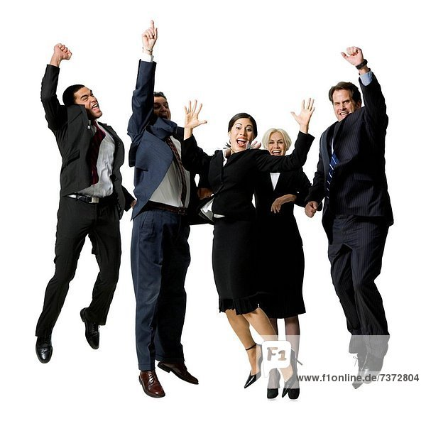 Group of five businesspeople leaping