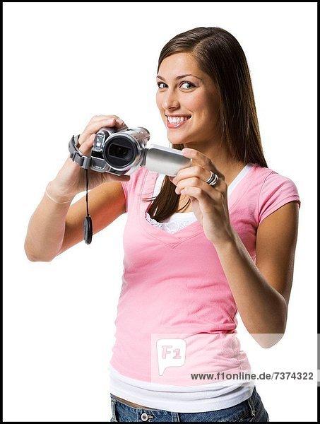 junge Frau junge Frauen Portrait halten Camcorder