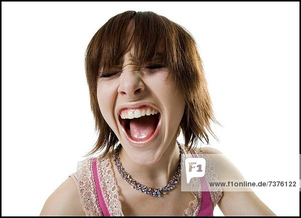 Close_up of a teenage girl shouting