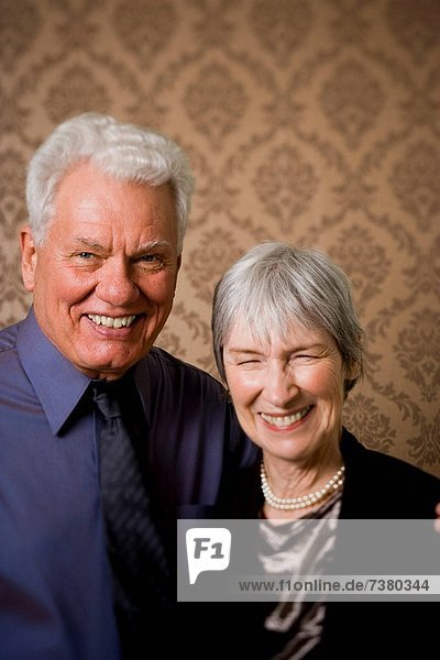 Portrait of an elderly couple standing together